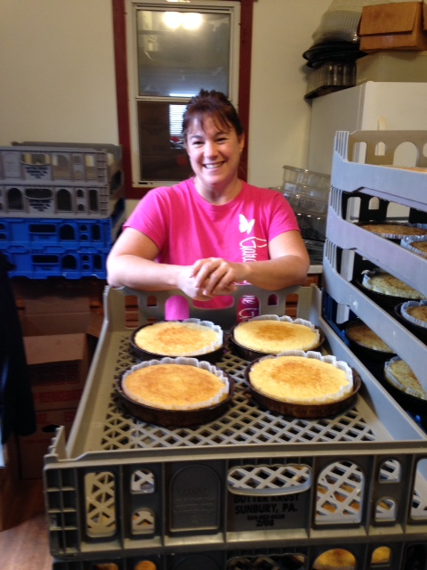 Heather Kuykendall with freshly baked coconut cakes